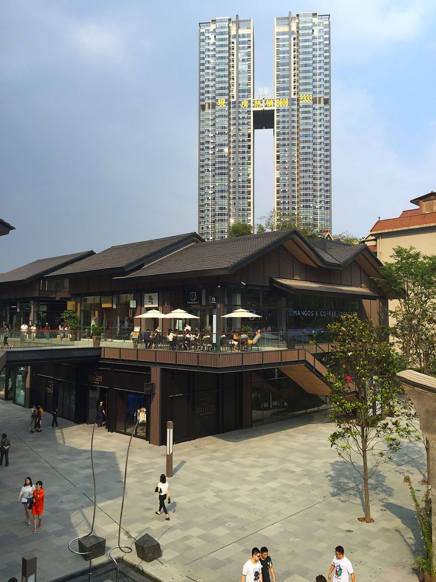 Fig. 1 Redeveloped condominiums and shopping area in the inner city of Chengdu, photographed by Qinran Yang in 2015. The fifty-one-story Excellency residential apartment is the first project of Singapore Land Limited's in Chengdu. The Taikoo Li shopping area developed by the Swire Properties of Hong Kong and Sino-Ocean Land of Beijing represents cutting edge commercial buildings in Chengdu.