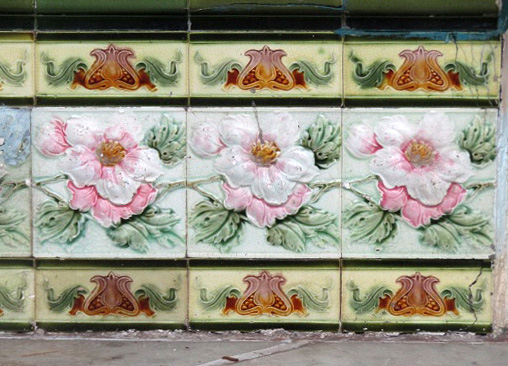 Ornate Peranakan-style tiles featuring stylized designs such as English country roses restored on a Peranakan shop-house in Jonker Street.